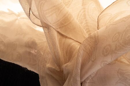Texture, background, pattern, sensation, cambric - very thin translucent soft mercerized fabric, beige