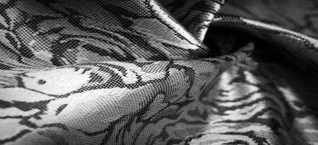 relief pattern, composite textile, silk fabric in black and white, with a floral pattern, unusually pleasant visual sensations: slippery, coolness, softness; beautiful appearance, unique shine