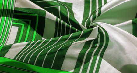 Texture,  silk fabric with a green striped pattern. The design of this fabric is devoted to a patchwork mosaic in the style of a white rabbit, representing what a fairytale's vest might look like.