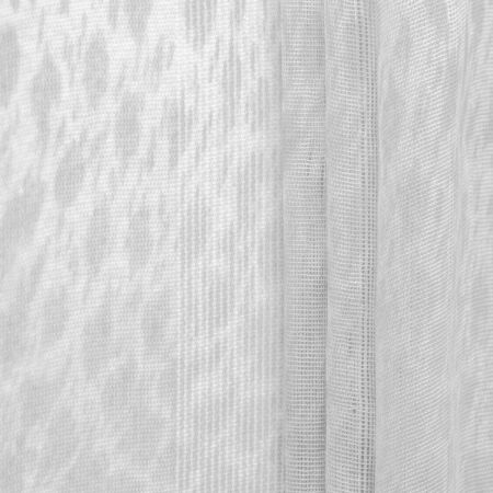 The texture, background, pattern, white silk fabric is textile. Its properties differ from woven material in that it is more flexible and easier to design.