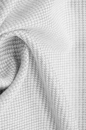Background texture, pattern Fabric warm wool with stitched gray thread. Shake things with this white wool knit. Oversized, stocky knitwear is a modestly structured drape.