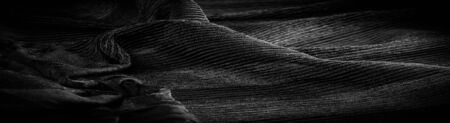 Texture, background, pattern, Crepe black, is a fabric of silk, wool or synthetic fibers with a distinctly clear, crimped appearance. Crepe is also historically called crêpe or crisp Reklamní fotografie