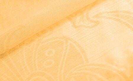 Texture, background, pattern, sensation, cambric - very thin translucent soft mercerized fabric, amber yellow Archivio Fotografico