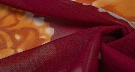Texture, background, burgundy silk fabric with a pink floral print. Your projects are developed in our studio by designers who have deep knowledge in the use of their final product.