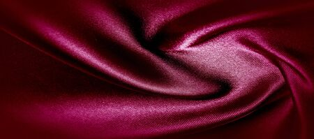 texture, red silk fabric panoramic photo. Silk Duke mood satin - beautiful and regal. It has a darker luster, then the usual satin on the one hand, has an average weight and has a more solid hand. Foto de archivo