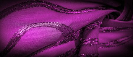 the ornament of the decor, the transparent fabric is purple-red with brightly innate stripes, the material allowing the light to pass through it so that the objects behind are clearly visible. 스톡 콘텐츠