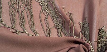 Background texture of silk fabric. This is a natural brown scarf, this beautiful nylon satin made of artificial silk with a clear hand and a wonderful sheen is perfect for your projects. Banque d'images