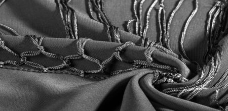 Background texture of silk fabric. This is a natural black scarf, this beautiful nylon satin made of rayon with a transparent hand and a wonderful sheen is perfect for your projects.. Stock Photo