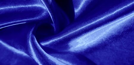 Texture, background, pattern, silk fabric in blue. This adorable, soft and shiny fabric has a smooth mink surface, perfect for creating your projects. Archivio Fotografico