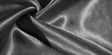 Texture, background, pattern, silk fabric in black. This adorable, soft and shiny fabric has a smooth mink surface, perfect for creating your projects.