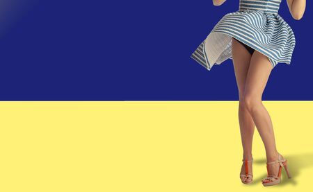 A girl in a striped dress, nautical theme; vest; coloring of the dress; the wind lifted the hem; black panties are visible; Reklamní fotografie