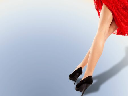 the girls legs, the red dress raised by the wind, the wind, studio photography, the panties are visible from under the dress,