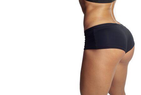 Photo studio d'un modèle sur fond noir, Remise en forme pour un mode de vie sain, Beau cul, muscles sculptés, manque de graisse sous-cutanée ou son minimum,