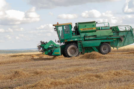 Summer photo of barley harvesting, Combine harvester, a machine commonly used for harvesting grain 2019 09 06 Tukaevsky district Tatarstan Russia