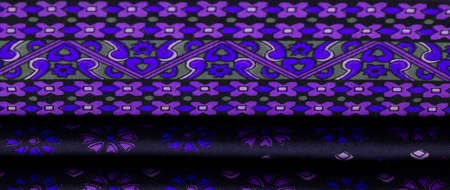 silk fabric of dark blue color with blue and purple flowers, dense fabric, double-sided based on triacetate fibers.