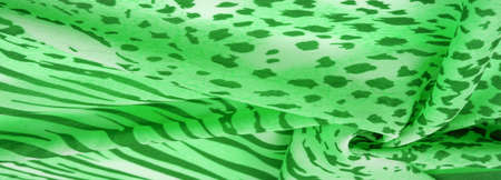 silk fabric with green-white stripes, zebra skin in African style. For the designer, the sketch of the layout, the entourage of the decorator. Background texture collection Stock fotó