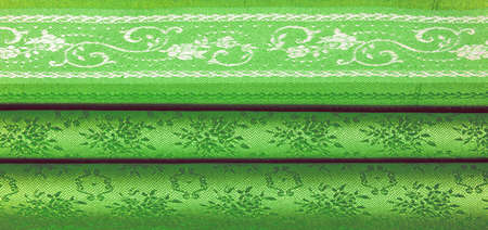 green silk fabric. Smooth elegant green silk or satin luxury fabric texture can be used as an abstract background. Luxury background design. Texture, pattern