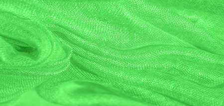 Bright green material. This silk is exceptionally smooth and soft, with a beautiful smooth texture. background pattern Standard-Bild - 161768787