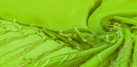Green silk shawl with fringe at the edge of the fabric. This is a common type of tie. Warm green on a white background. Template