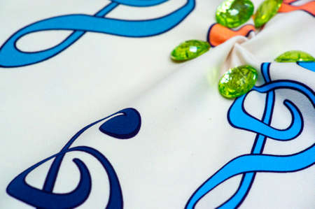 cotton fabric with treble clef print. Green sewn on rhinestones, Branded cotton fabric. Design Patchwork Quilt Decor Crafts