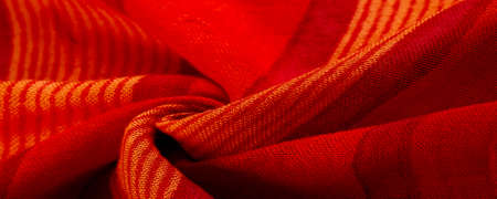 Texture. Background. fabric red-burgundy, with a print of yellow lines. wine from Burgundy fabric color Foto de archivo