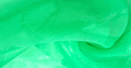 Green silk fabric, abstract background from emerald silk. Fabric texture with drapery. Copy space. Design element. Valentine's Day. Texture pattern, ornament, background Stockfoto - 168145028