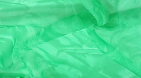Green silk fabric, abstract background from emerald silk. Fabric texture with drapery. Copy space. Design element. Valentine's Day. Texture pattern, ornament, background Stockfoto - 168144341