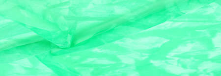 Green silk fabric, abstract background from emerald silk. Fabric texture with drapery. Copy space. Design element. Valentine's Day. Texture pattern, ornament, background Stockfoto - 168144010