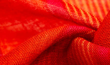 fabric red-orange with yellow stripes, This bold and bright fabric for your projects. With many soft plains in a huge variety of colors, Texture Foto de archivo