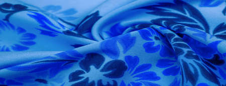 delicate blue silk with floral print Exceptionally lightweight pure silk fabric with a delicate texture. Clean, use lining when opacity is desired.