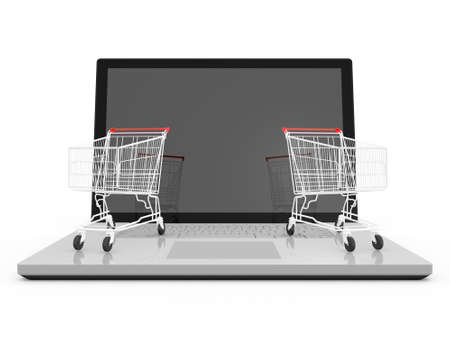 Two red shiny shopping carts on laptop with reflection to blank screen, isolated on white background. photo