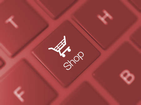 Shop key and shopping cart icon on red blurry keyboard. photo