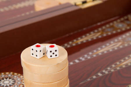 Backgammon table, chips and dices with double one.