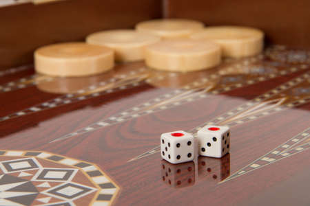 battle plan: Backgammon table, chips and dice with double one.