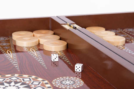 double the chances: Backgammon table, chips and dice with double six.