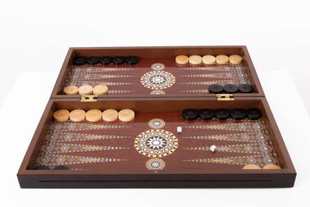 battle plan: Backgammon set with table, chips and dice at the beginning, isolated on white background. Stock Photo