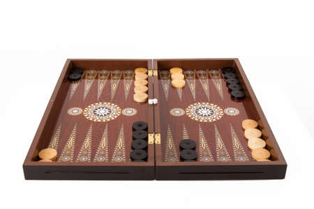 Backgammon set with table, chips and dice at the beginning, isolated on white background. Stock Photo
