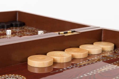 Backgammon table, chips and dices, isolated on white. Stock Photo