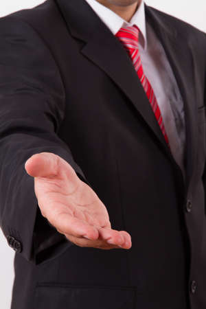 extends: Businessman extends hand to shake or helping, isolated on white. Stock Photo