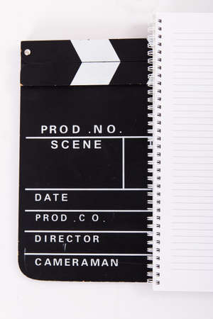 Black cinema clapper board and notebook for scenario, isolated on white background. photo