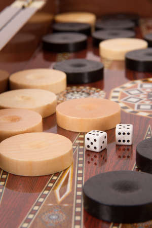 backgammon: Complicated backgammon chips and dices with six and five. Stock Photo