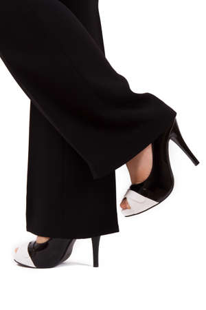 Young business woman with dark suit shows her feet and shoes. photo