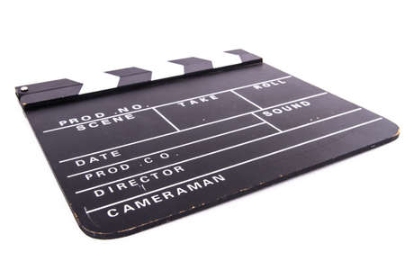 Blank old black cinema clapper board, isolated on white background. photo