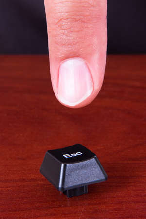 esc: Index finger pointing ESC key.