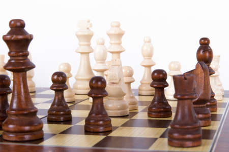 Chess pieces on board, isolated on white background. photo