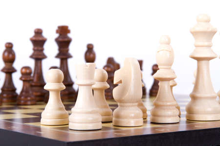 Chess board with chess pieces in a row, isolated on white background. photo