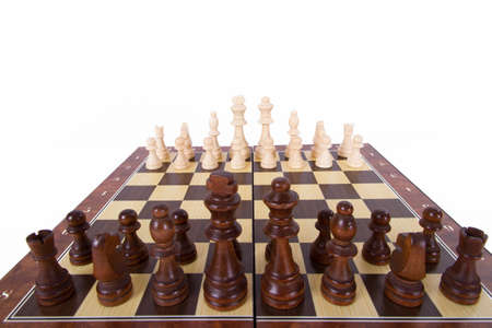 Chess board with with chess pieces in a row, starting position, wide angle, isolated on white background. photo