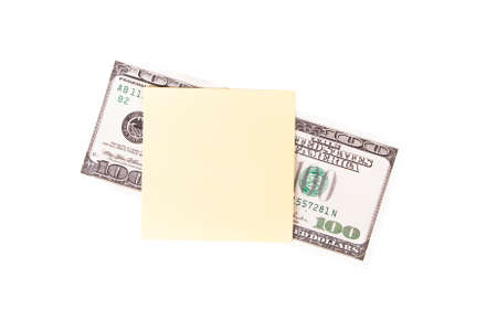 One hundred dollar bill with yellow, blank, empty sticky post it note for your message, isolated on white background.