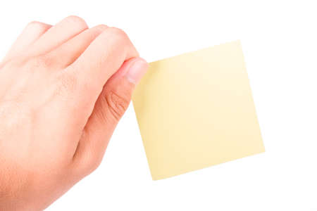 Hand holding blank, empty, yellow sticky post it note with copy space, isolated on white background. Stock Photo - 22621898
