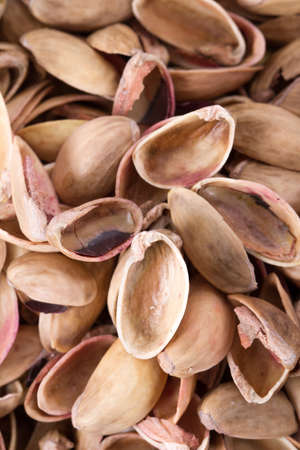 nutshells: Heap of pistachio nutshells background. Stock Photo